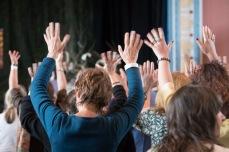 Hands waves back